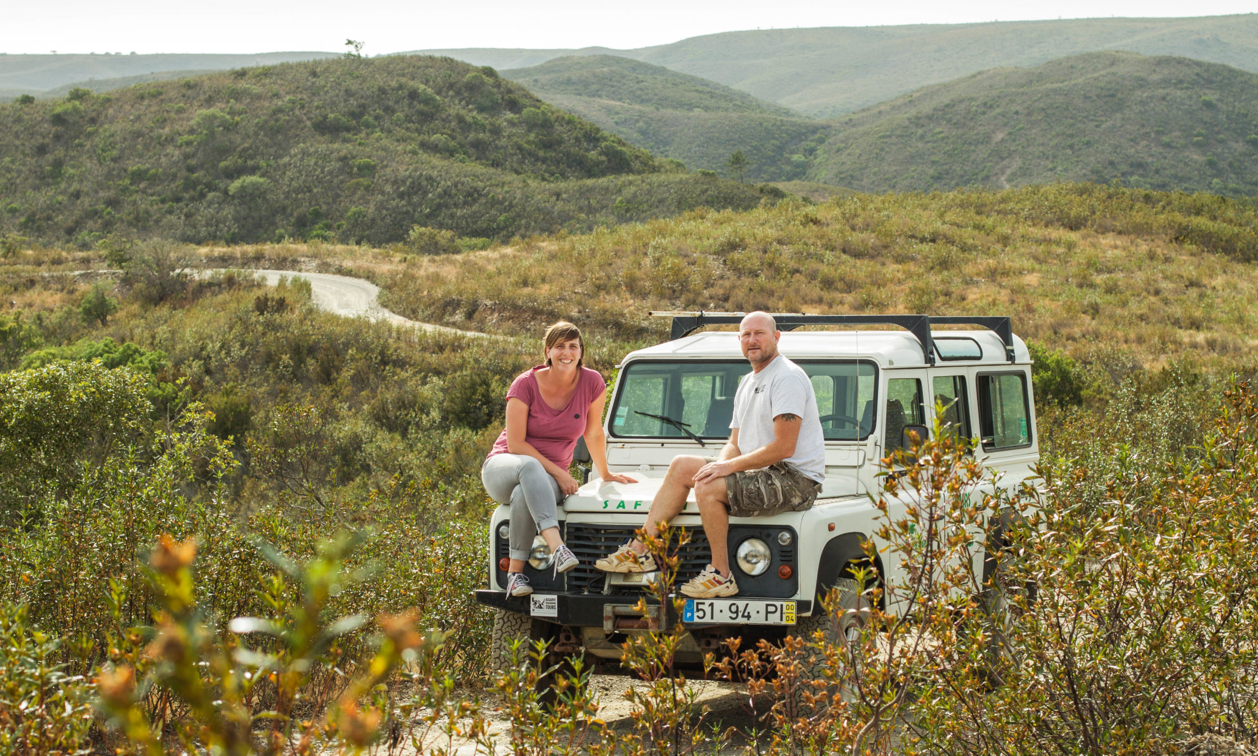 Jeep rides through scenic mountains in Algarve Portugal